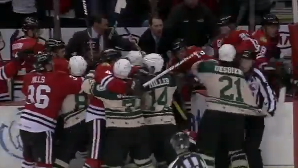 Yep. Another brawl featuring the IceHogs and ridiculous jerseys.