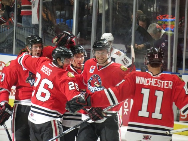 IceHogs defenseman Klas Dahlbeck celebrates his 3rd period goal on Sunday afternoon. (Photo Credit: Kim Wrona)