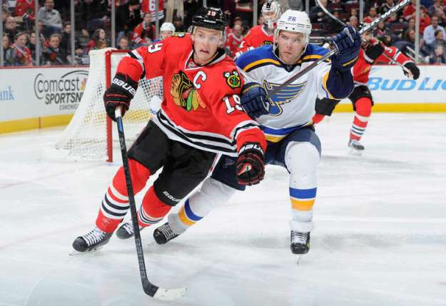 Pictured: Toews dragging a trash bag behind him.